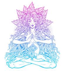 Sacred motherhood. Beautiful boho pregnant woman in lotus position with long hair.