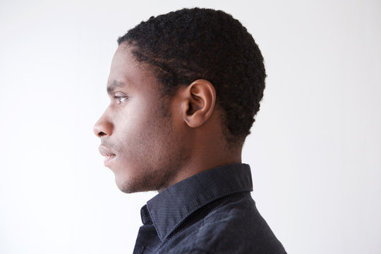 Profile young african man against white background
