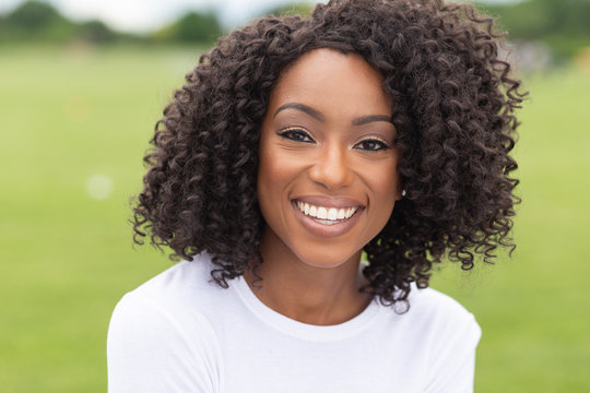 smiling portrait of african-american woman in park