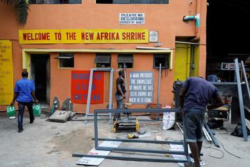 Artisans work inside the Afrikan shrine, a day before the arrival of France President Emmanuel Macron, in Lagos.