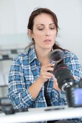 woman looking at broken photographic lense