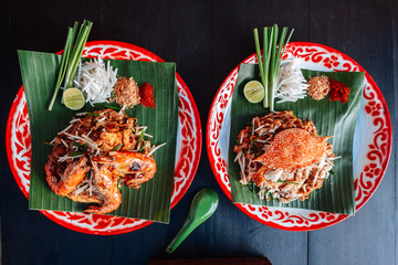 Prawn or Shrimp and Crab Pad Thai served with lime, scallions, bean sprouts. crushed peanut and chili powder.