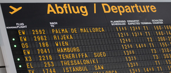 Airport flight information on a large screen international departure board
