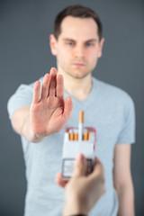 man showing hand stop smoking