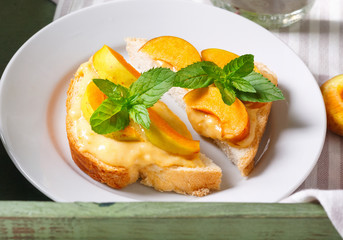 Delicious toasts bread with homemade apricot jam on wood tray