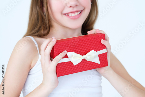 Little Girl Holding A Present In Gift Box For Her Mom Or Dad Birthday
