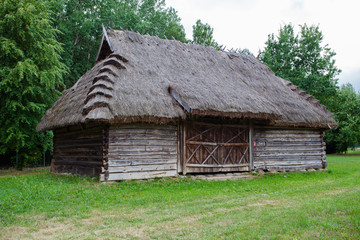 Barn with a thatched roof in a village in Poland