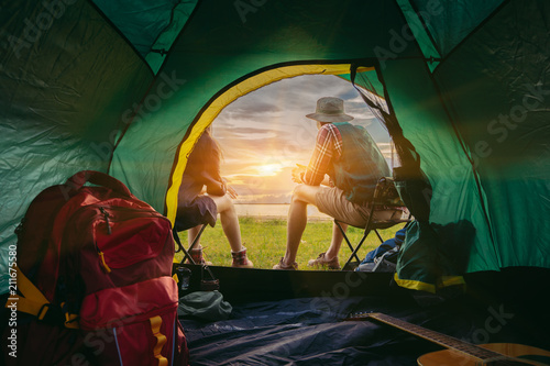 Couple asian travel c&ing together in forest Happy and relax young man and woman sitting on chairs near tent with backpackguitar looking mountain ... & Couple asian travel camping together in forest Happy and relax ...