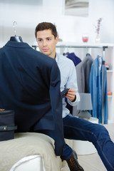 businessman travel packing a suitcase