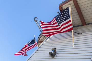 Two American Flags On A Historic House
