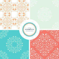 Vector set of four backgrounds with seamless abstract patterns. Curls and leaves, flowers and dots.