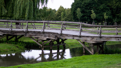 Wooden bridge leading to the park side view
