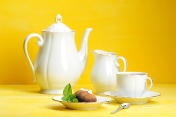 Tea, tea and pastries with mint leaves