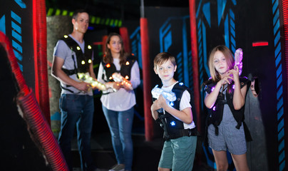 Brother and sister playing laser tag