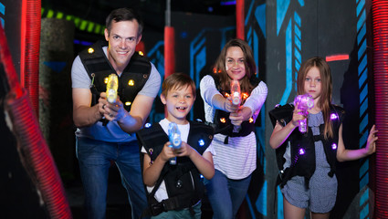 Kids and adults on lasertag arena