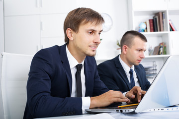 man manager working on laptop in office