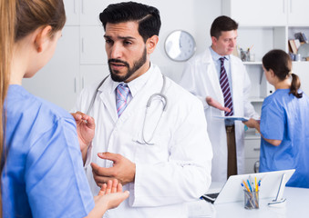 Doctors discussing in office