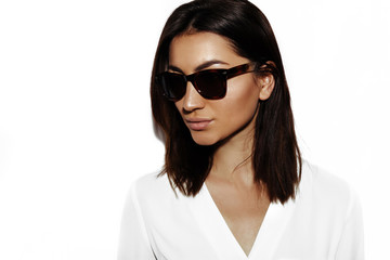 Confidence and stylish. Young brunette woman portrait in black sunglasses. Summer fashion concept