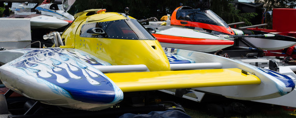 Close-up of a group of colorful hydroplane racing boats