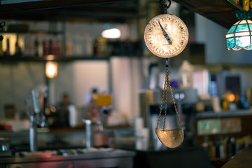 Classic Vintage copper scale in an old marketplace interior shot in Grand Central Market, Los Angeles with a picturesque blurred background