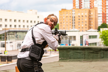 Powerful man Holding Gun. War Action Movie Style