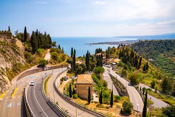 Narrow Italian streets down the mountain by the sea on Sicily island.