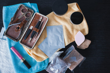 Cosmetics products background. Woman's set for everyday care. Hairstyle gel, manicure kit, soap and face organic mask