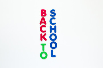 colorful foam letters spelling the words Back to School in vertical rows isolated on white