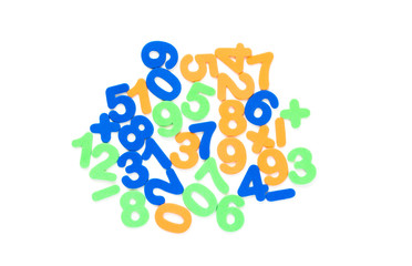 colorful foam numbers and math symbols  jumbled up isolated on white
