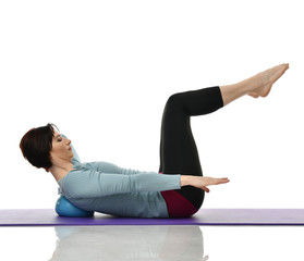 Mother woman exercising doing postnatal workout. Female fitness stretching hands and legs in gym work out exercises