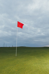 golf course and red pin flag