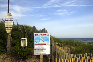 Ditch Plains Montauk New York rip current warning and surfer rule signs