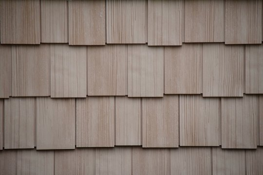 tan staggered shake siding construction exterior