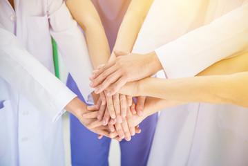 Medical team stacking hands together with vintage filter,medical teamwork concept.