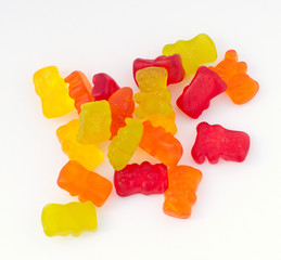 Macro picture of colorful gummy bears isolated on white background.