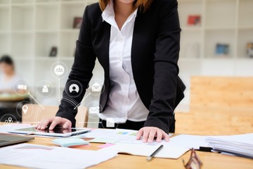 Business woman working with tablet computer analysis data of finance and visual icon technology.