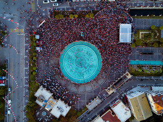Social event on the main square of the city, drone photo