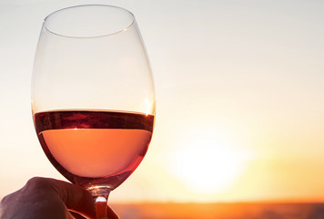 A glass of rose wine on the sunset