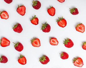 Ripe strawberries on the white background.