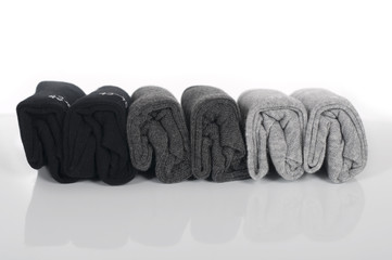 male socks twisted into rolls and folded in a row