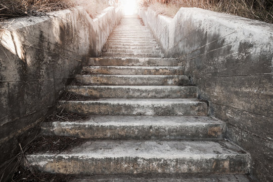 Old concrete stairway with glowing end