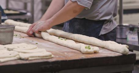 Chef making sesame bread in restaurant