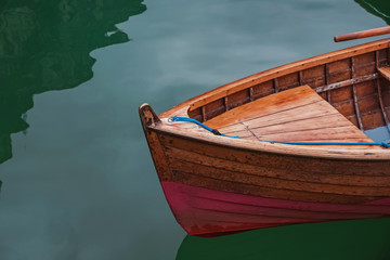 Wooden boat on the beautiful lake