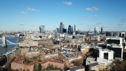 Aerial drone bird's eye view of iconic skyline in City of London as seen from St Katharine Docks Marina, London, United Kingdom