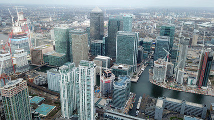 Aerial bird's eye view photo taken by drone of famous Docklands and Canary Wharf skyscraper complex, Isle of Dogs, London, United Kingdom