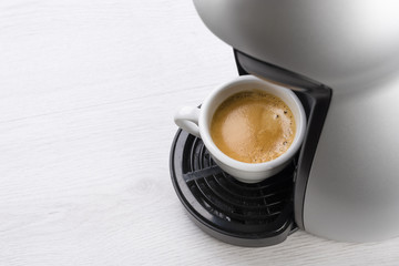 cup of coffee just filled on the machine