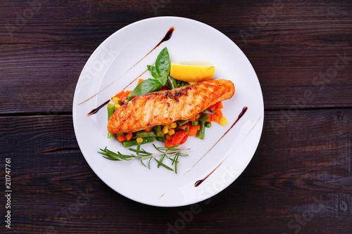 Delicious Grilled Salmon Steak With Vegetable Garnishing Flat Lay
