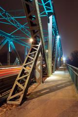 Moving car with blur light through Pilsudski Bridge at night in Torun. Poland. Europe.