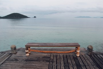 Wooden chair with blue sea background