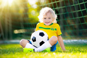 Brazil football fan kids. Children play soccer.
